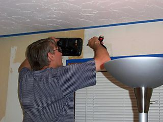 Wayne removing Wall Paper