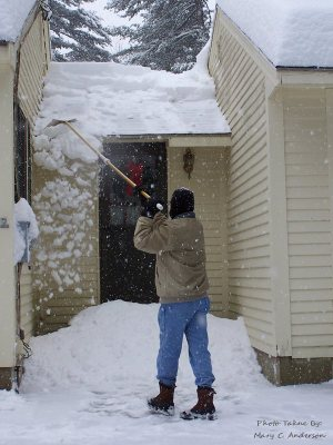 Wayne_cleaning_off_roof